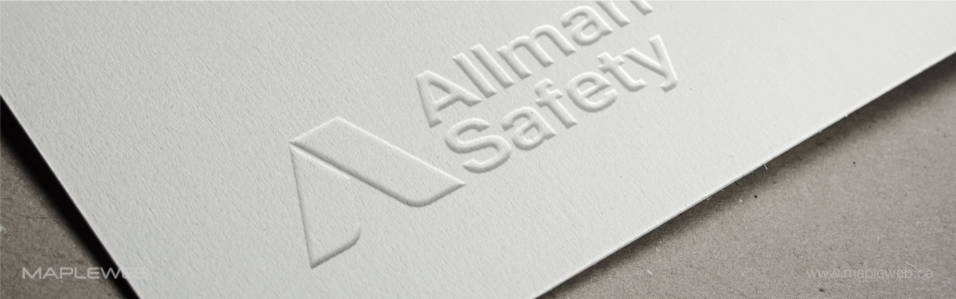 allman-safety-brand-logo-design-by-mapleweb-vancouver-canada-white-paper-black-logo-mock